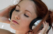 holding-headphones-listening-to-music-3