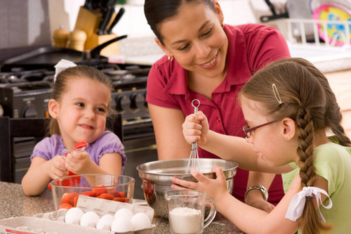mom-and-daughters-cooking