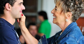 Coleen--Grandmother-pinching-grandsons-face