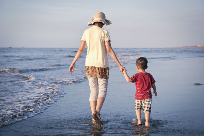 mother-and-boy-walking-on-the-beach-1