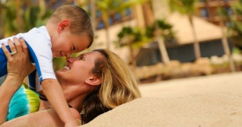 aulani-beach-detail-mom-holding-son-on-beach-hero