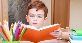 Child-Reading-A-Book-At-A-Desk-Shutterstock-800x430