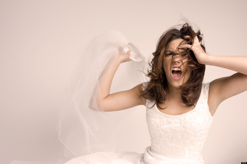 Angry Screaming Bride Throwing Veil on White, Copy Space
